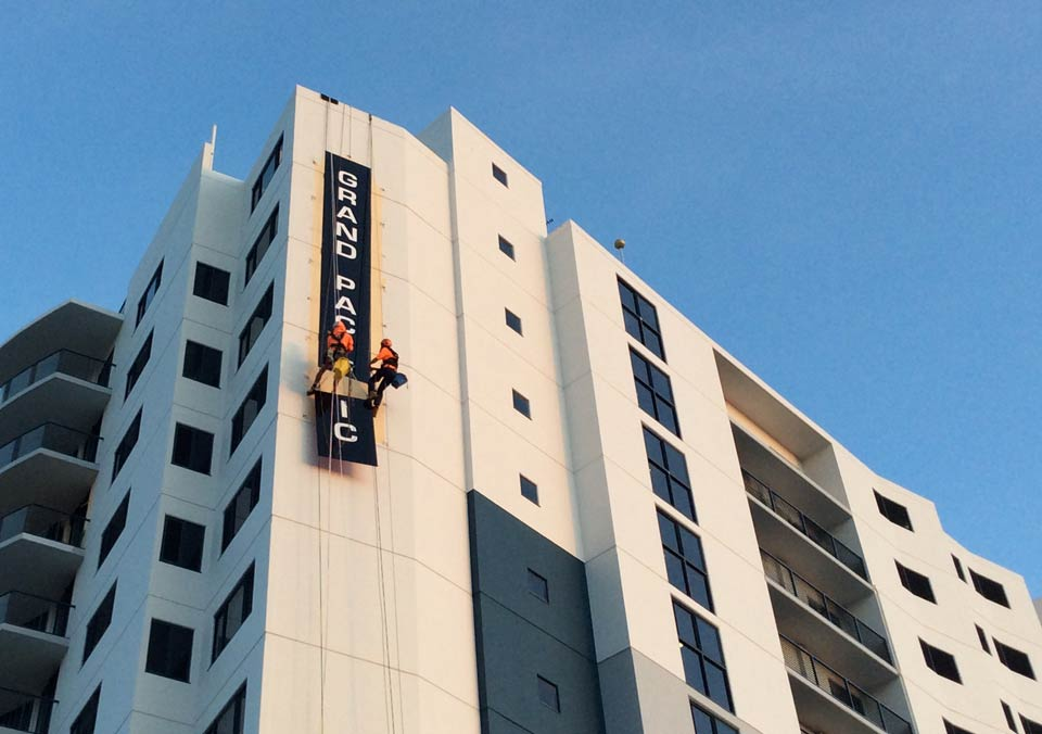 Abseilers Installing a sign on Sunshine Coast - rope access