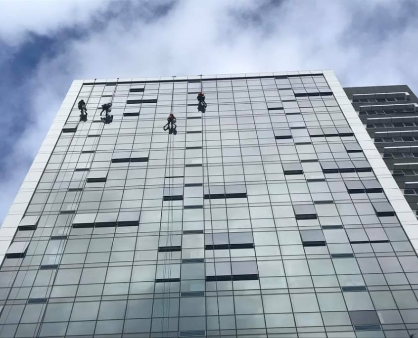 Commercial Window Cleaning - High Rise Building getting windows cleaned