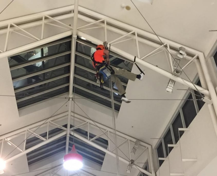 Height Safety Inspections - Alltech Abseiler descending from roof top