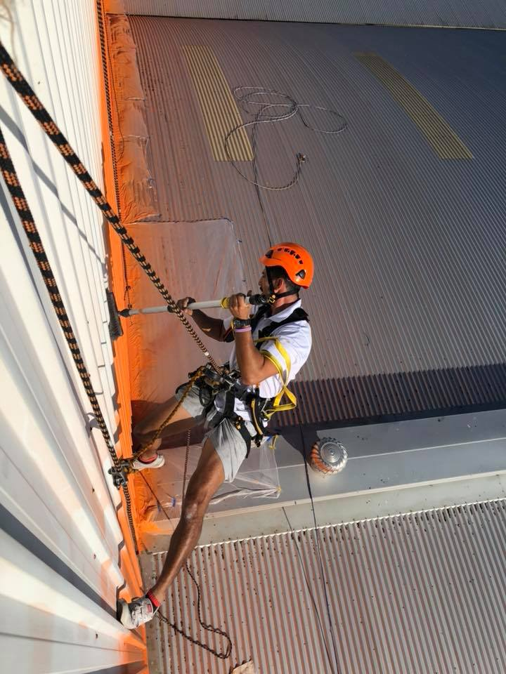 Commercial Rope Access Painters Abseilling - Outdoor Building getting painted orange