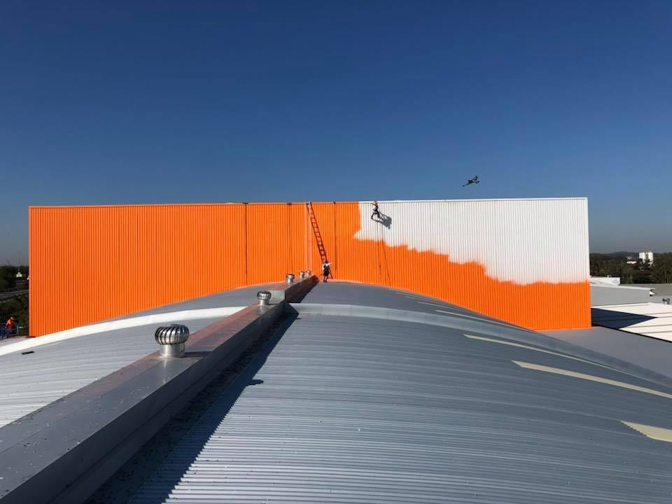 Rope Access Industrial Abseilers Commercial Painting Showing Progress - Company Branding Industrial Shed